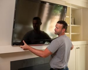 My Home Handyman installing wall mount tv