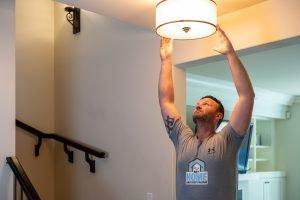 My Home Handyman installing a light fixture